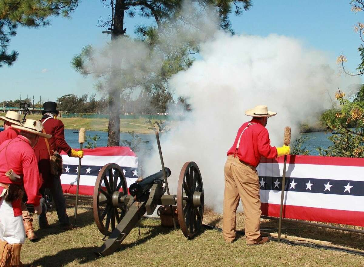Members of the Sons of the Republic of Texas fire the ceremonial cannon.
