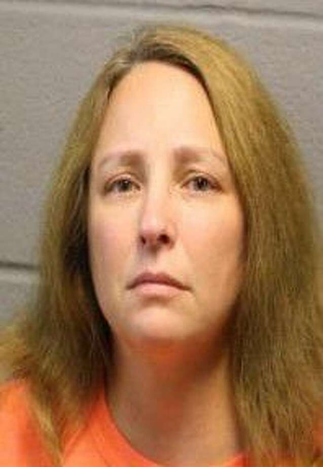 Pearland resident Lori Ann LoPresti, 45, was arrested and booked into the Harris County Jail on Wednesday, June 9. She is currently being held on a $30,000 bail on felony charges of Aggravated Sexual Assault of a Child under 14 years old. Photo: Courtesy Friendswood Police