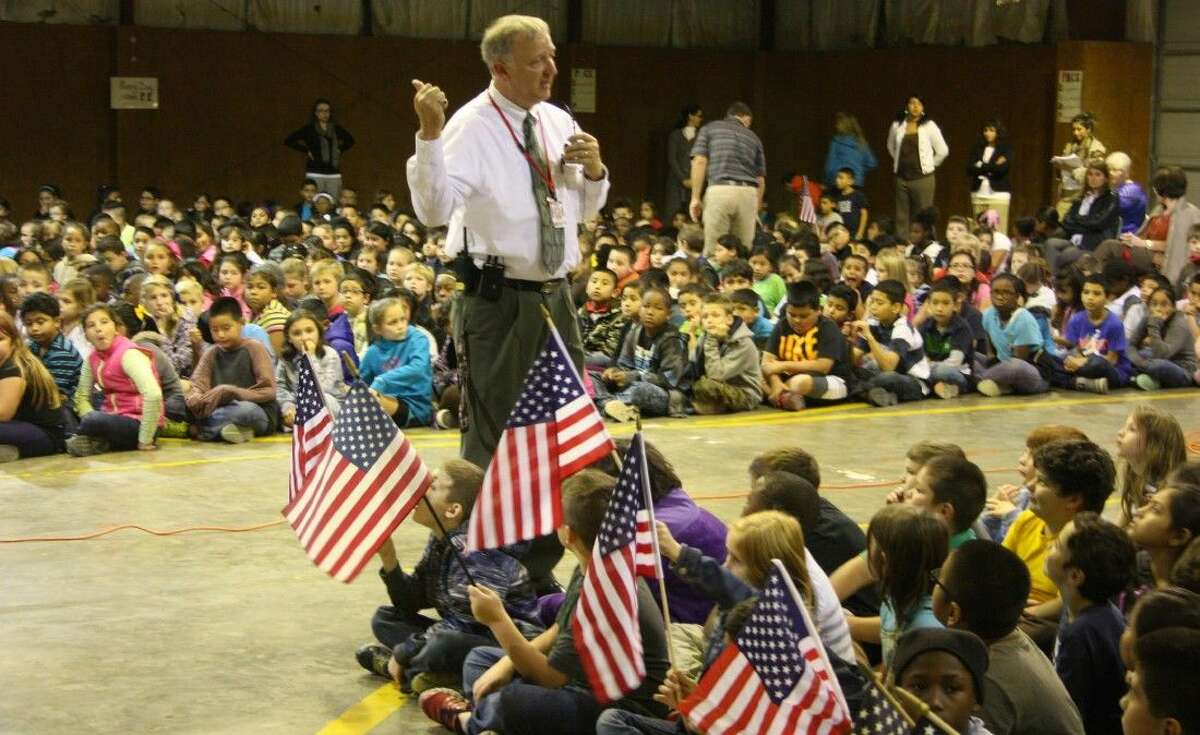 Northside Elementary Principal Edward Husk teaches the students about Veterans Day and why honoring and thanking veterans today is important.
