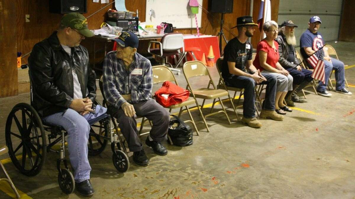 Veterans sit on the side of the gymnasium at Northside Elementary in Cleveland on Veteran's Day. Students present at the event said thank you to these brave men and women. From left to right are Chris Hubbs, Donald Johnson, Allen Ehrlich, [unidentified], Johnny Dain and Timothy Huff.