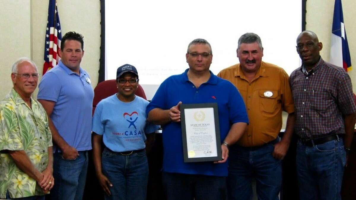 Mayor Jeff Lambright holds a certificate presented to the City of Dayton by the Texas General Land Office in recognition of the city's excellent performance administering Hurricane Ike recovery grant funds provided by the GLO. With Lambright, from left, are council members John Johnson, Josh Townsend, Sherial Lawson, Troy Barton and Dwight Pruitt.