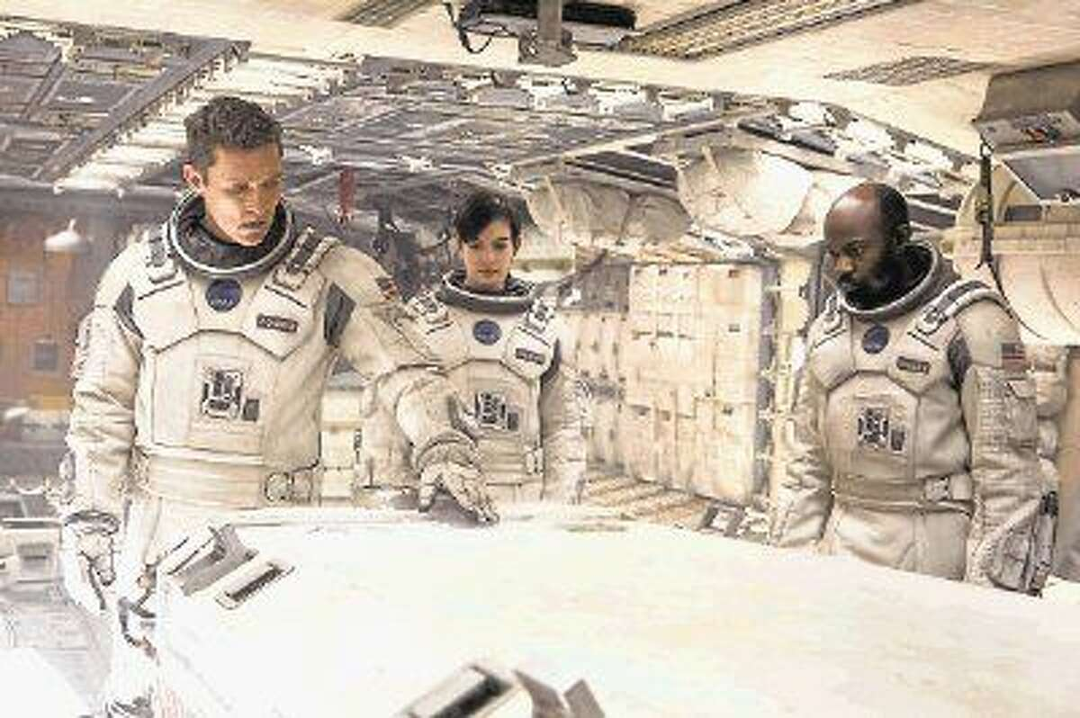 Matthew McConaughey, left, Anne Hathaway and David Gyasi in a scene from the motion picture