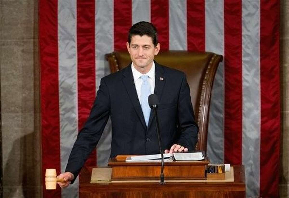 Newly elected House Speaker Paul Ryan of Wis., gavels in the House Chamber on Capitol Hill in Washington, Thursday. Republicans rallied behind Ryan to elect him the House's 54th speaker on Thursday as a splintered GOP turned to the youthful but battle-tested lawmaker to mend its self-inflicted wounds and craft a conservative message to woo voters in next year's elections.
