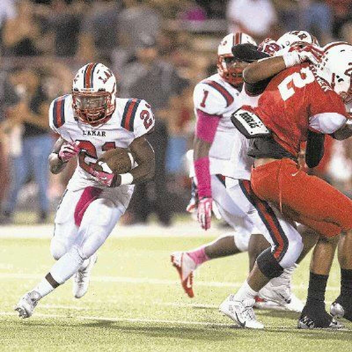 Lamar running back Ronnie Wesley looks for some room to run during a recent Texans victory. Lamar, along with Bellaire, will open up 6A Division I playoff action this week when both teams go to Katy to play their opening-round games. The Texans take on Seven Lakes while Bellaire will face Cinco Ranch for the third consecutive year.
