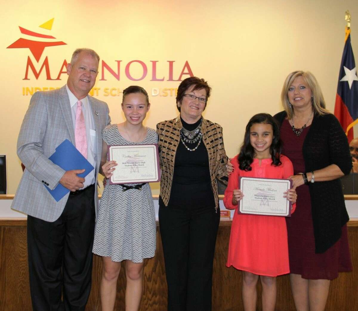 School Board President Deborah Rose Miller along with Principals Gerald Evans and Linda Kenjura honor their students Caitlin Martinucci from Bear Branch Junior High and Marcela Medina from Magnolia Elementary.