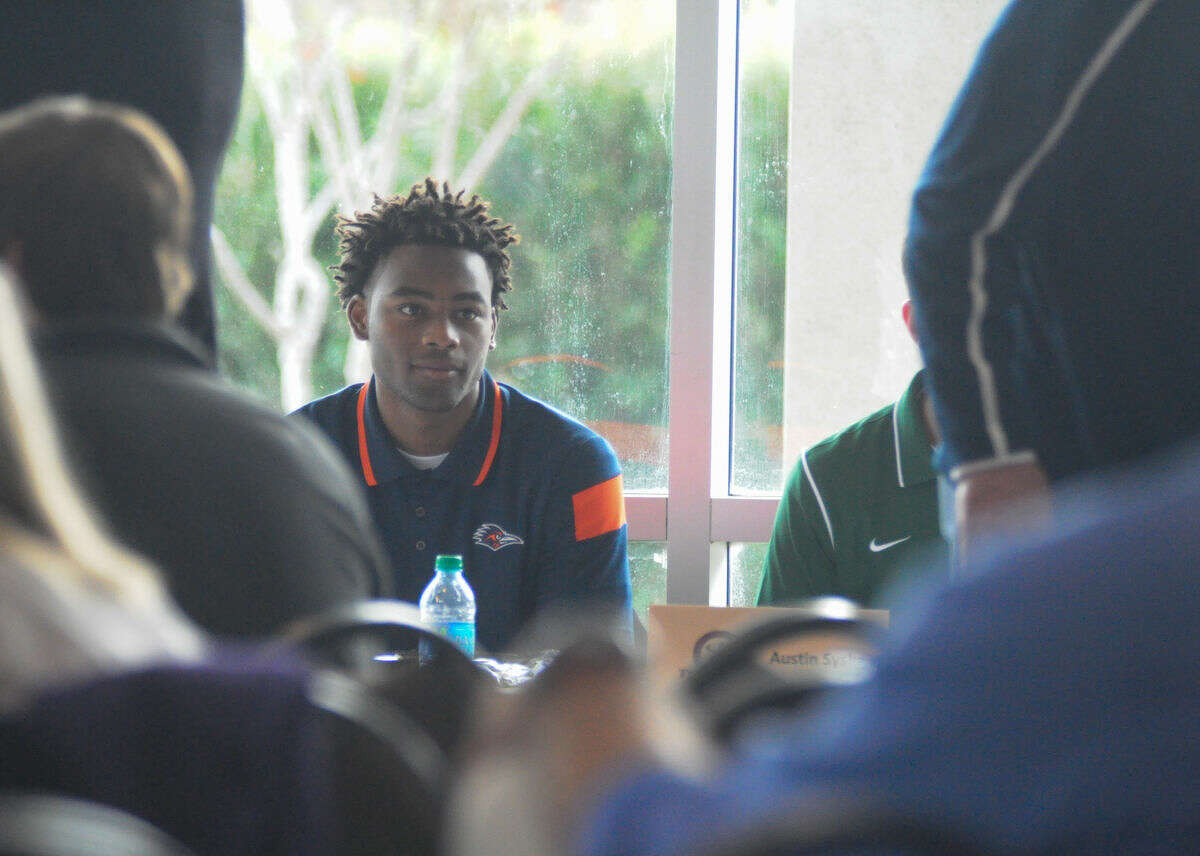 Kingwood's Jaylon Henderson waits before signing his national letter of intent to UTSA at a fall national signing day ceremony for Humble ISD at the Humble Civic Center on Wednesday.