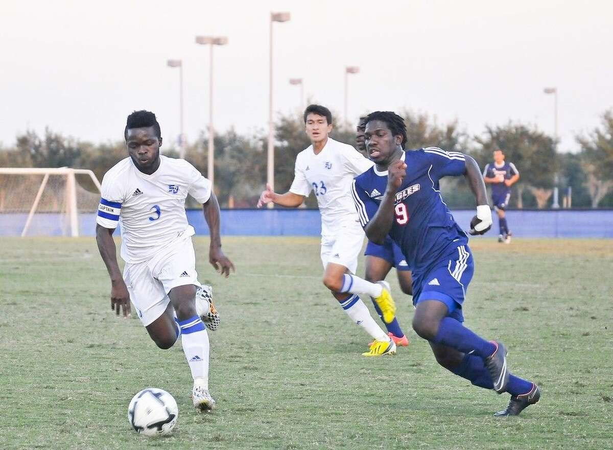 Though the San Jacinto College soccer team finished the 2014 season 9-11 overall, the team looks forward to improving technically and tactically during this off-season. Pictured: San Jacinto College right-back defenders, Prince Ihenacho (front) and Gonzalo Orozco (back). Photo credit: Andrea Vasquez, San Jacinto College marketing, public relations, and government affairs department.