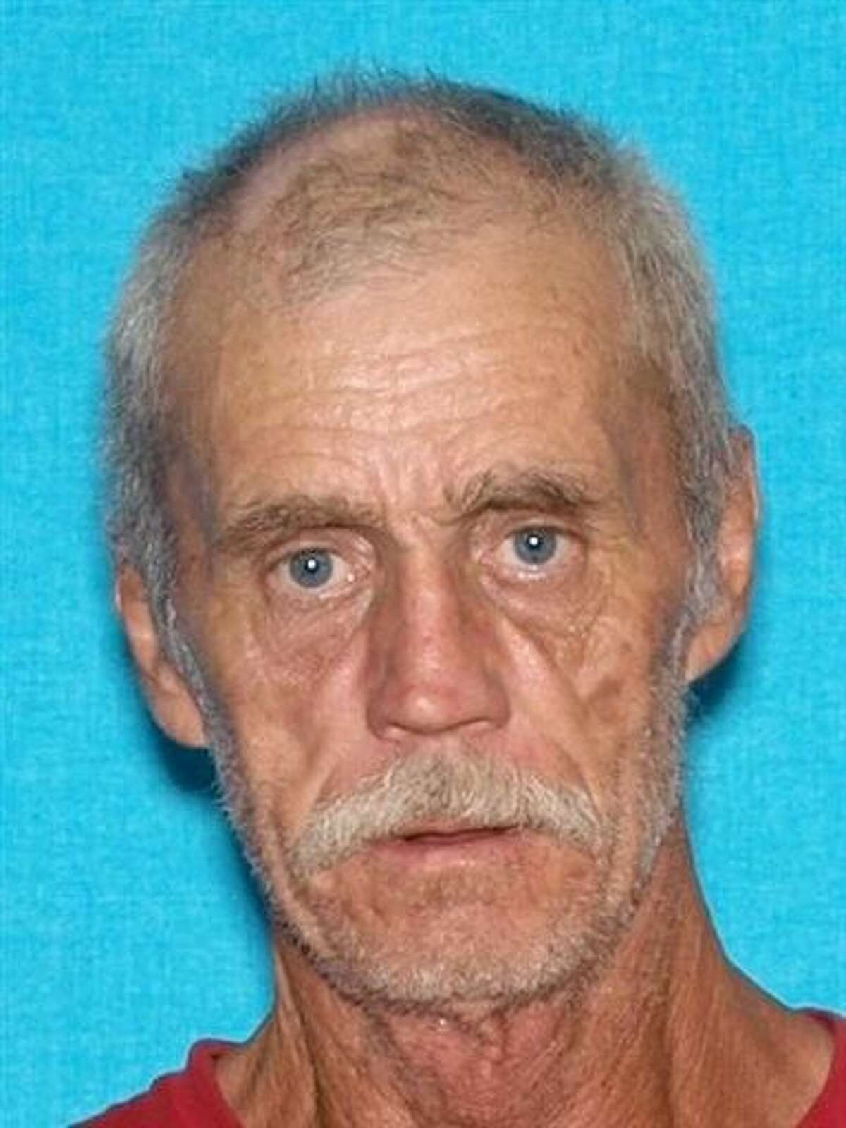 Floyd Ray Cook is seen in an undated photo provided by the Kentucky State Police. A manhunt is underway for Cook, who is accused of shooting and wounding a Tennessee police officer and then firing at a state trooper in Kentucky. Classes were called off Monday in Cumberland County as the manhunt continued.