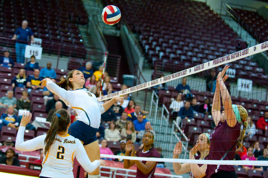 Alli Hymel is up for the spike in Cy Ranch's regional quarterfinal playoff game against Cinco Ranch on Tuesday. The Mustangs won 3-1. Photo: Tony Gaines/HCN