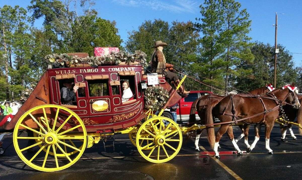 Wells Fargo was one of the many Magnolia Christmas Parade entries last year. This year the parade and all Hometown Christmas festivities are moving to Unity Park, for the Dec. 13 event.
