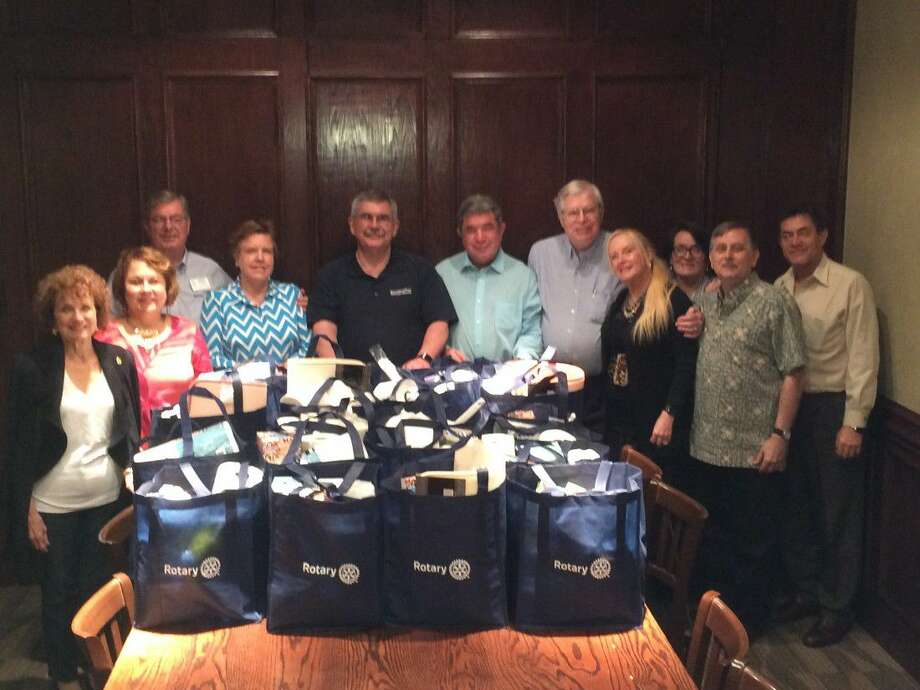 At the Kingwood Rotary Club's meeting May 26, members put together 25 gift bags that contained persona hygiene items and paper goods. Home Again Ministries can give the gift bags to their clients when they come to pick up their furniture and household items.