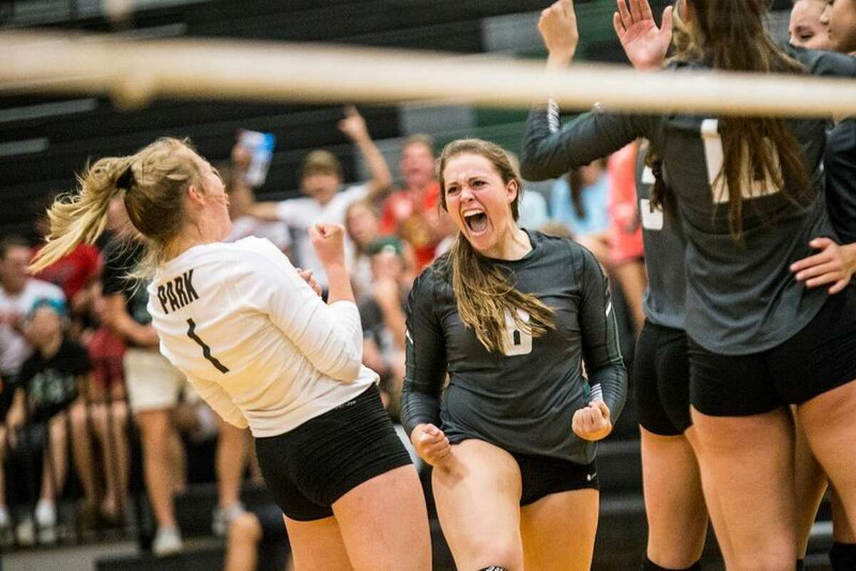 Kingwood Park volleyball players celebrate after a point during a match earlier this season.