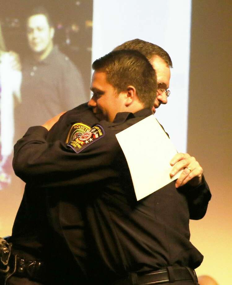 ACC Law Enforcement Academy graduate Joshua Van Wagenen, of Friendswood, receives a hug from his father, Houston Police officer Jeff Van Wagenen after Joshua received his certificate during a graduation ceremony on May 25.