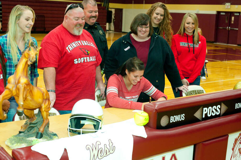 Magnolia West senior Torri Hedrick signs National Letter of Intent to play softball at Trinity Valley Community College.