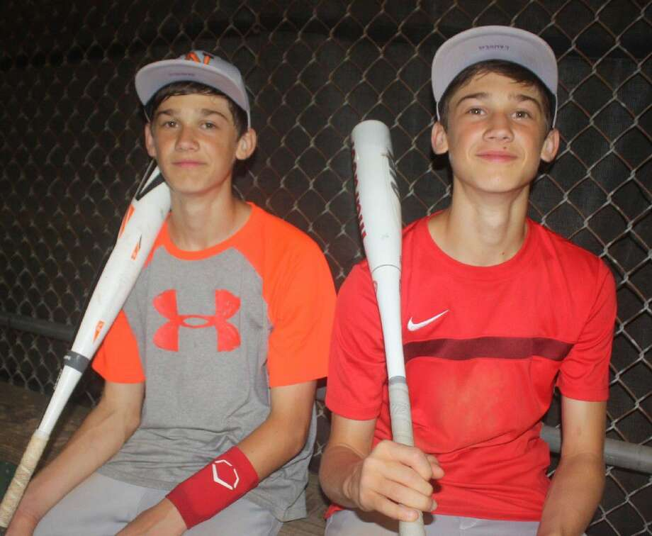 Opponents of NASA Green's 14-year-old Pony all-stars will be seeing double this summer thanks to Braeden (left) and Landen Shaffer, identical twins. Fans will need a scorecard for these two, but both could be members of NASA-Green's pitching staff. Photo: Robert Avery