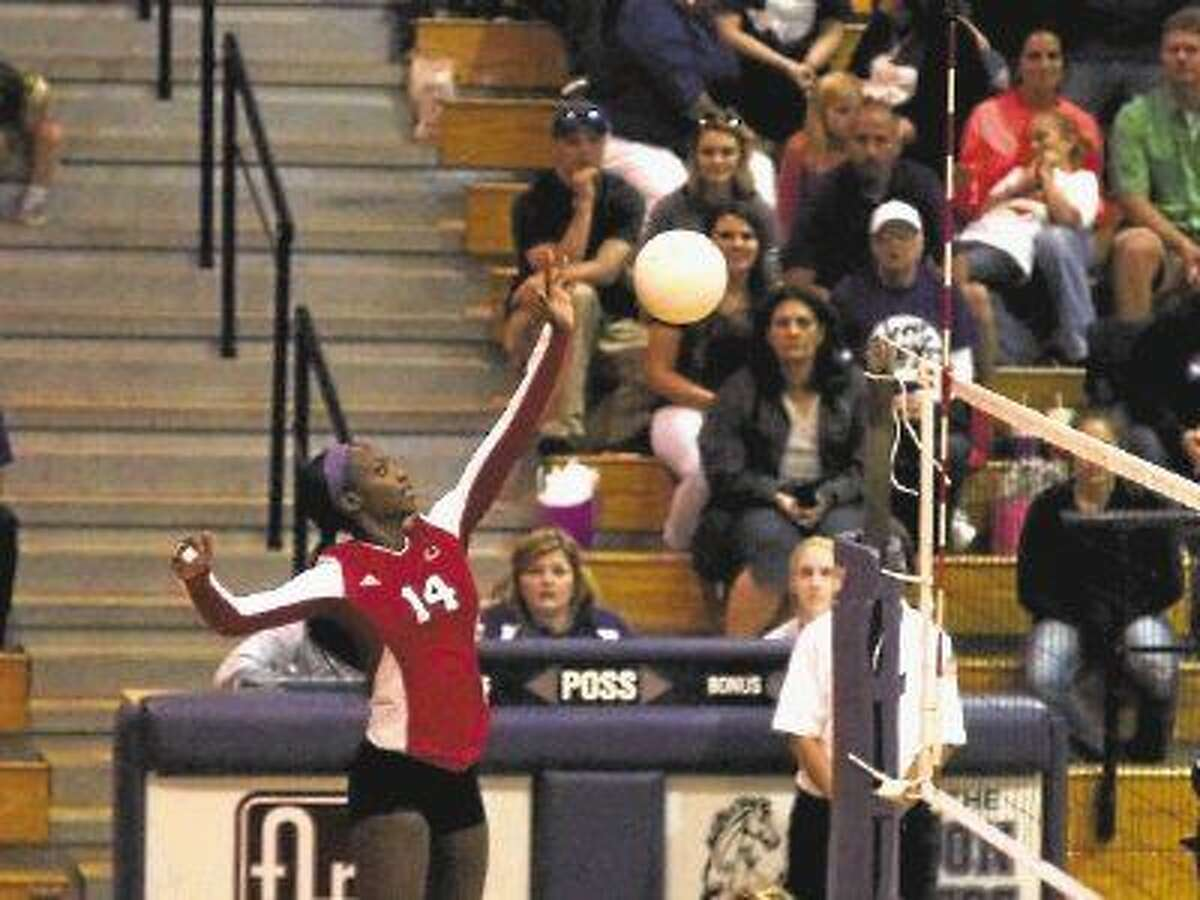 Crosby's Alaina Mouton makes an attack at Dayton, Oct. 16, 2015. She made 6 kills in the match and was the Lady Cougars' dig leader with 19 digs.