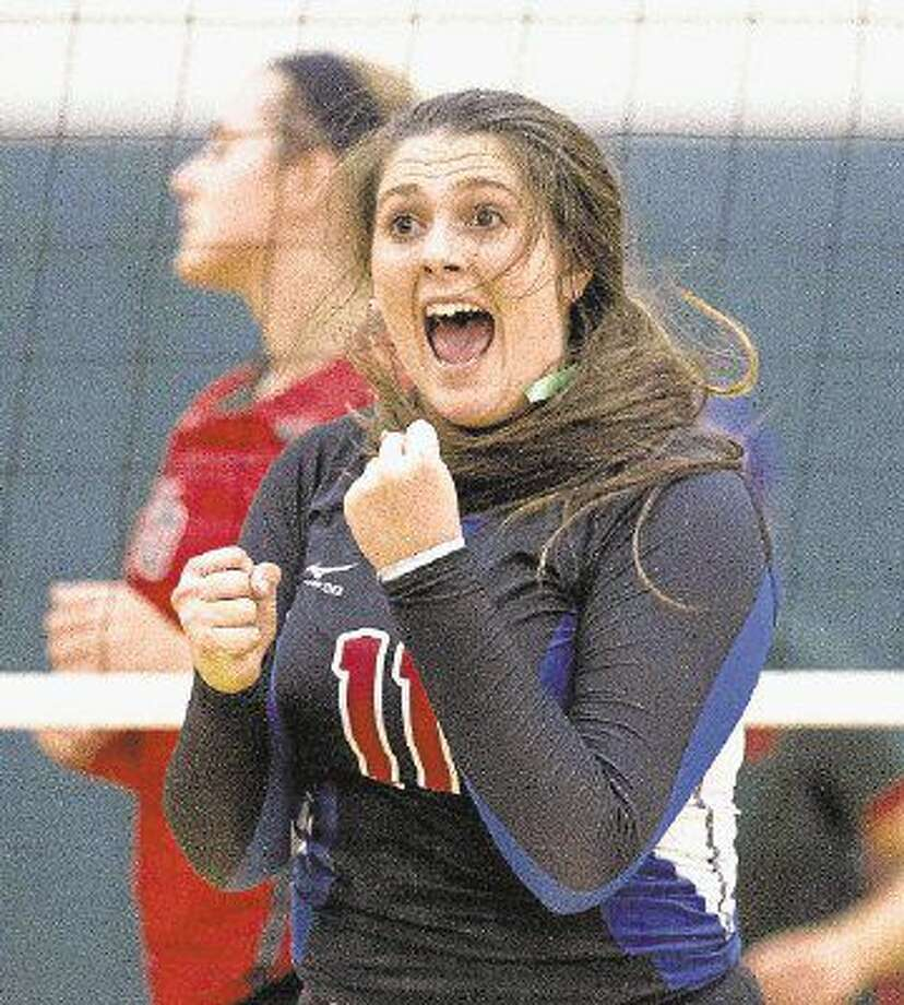 Oak Ridge's Carly Graham celebrates a block during a volleyball game. To view or purchase this photo and others like it, visit HCNpics.com. Photo: Jason Fochtman