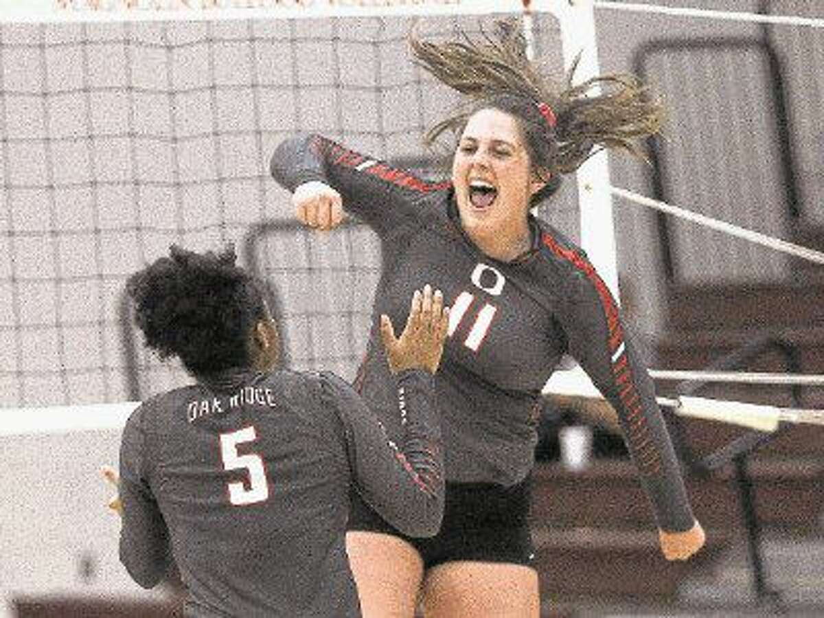Oak Ridge's Carly Graham celebrates a point during a high school volleyball game at the Magnolia Volley Battle Tournament. To view or purchase this photo and others like it, visit HCNpics.com.