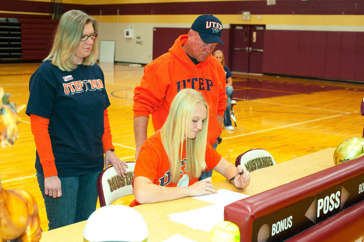 Magnolia West senior Lindsey Sokoloski signs her National Letter of Intent to play softball at UT El Paso. Photo By Tony Gaines