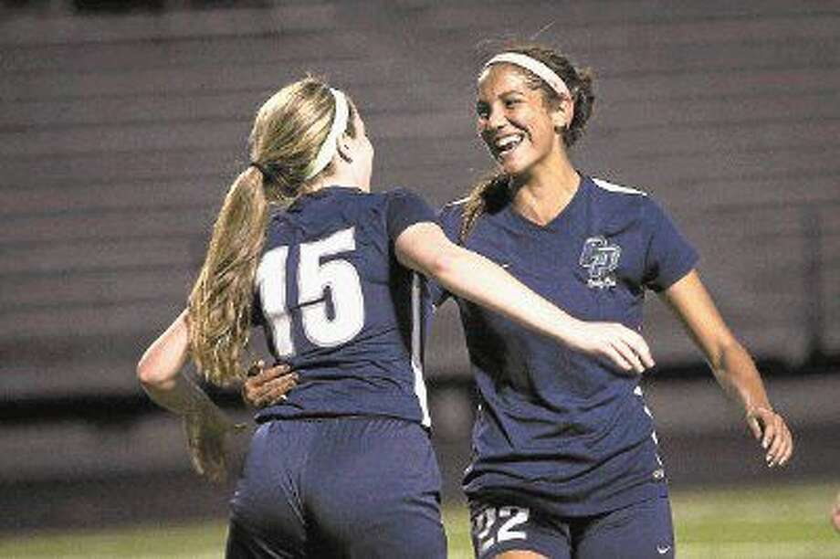 College Park's Isa Sanabria (22) and Katie Rabold (15) celebrate after scoring a goal during the high school girls soccer game against Conroe on March 18, 2016, at Moorhead Stadium. To view more photos from the game, go to HCNPics.com. Photo: Michael Minasi
