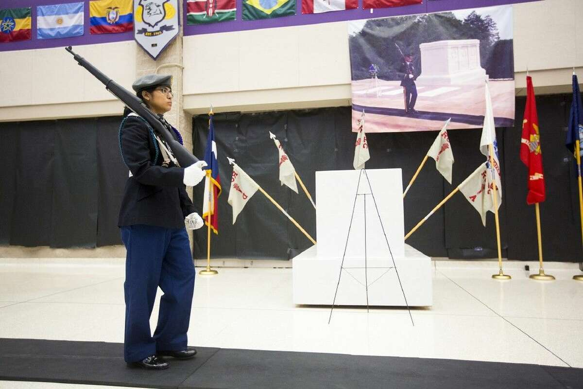 JROTC member Mirella Lerdo guards a replica of the Tomb of the Unknown Soldier during the Wildcat Salute honoring local veterans and current service members Nov. 11, 2014, at Humble High School.