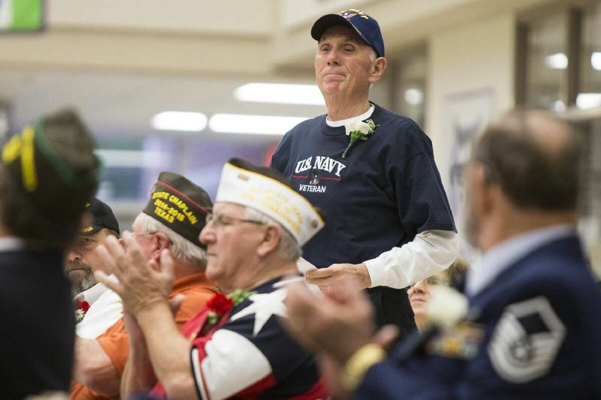 Terry Riggle is recognized for his service during the Wildcat Salute honoring local veterans and current soldiers Nov. 11, 2014, at Humble High School.