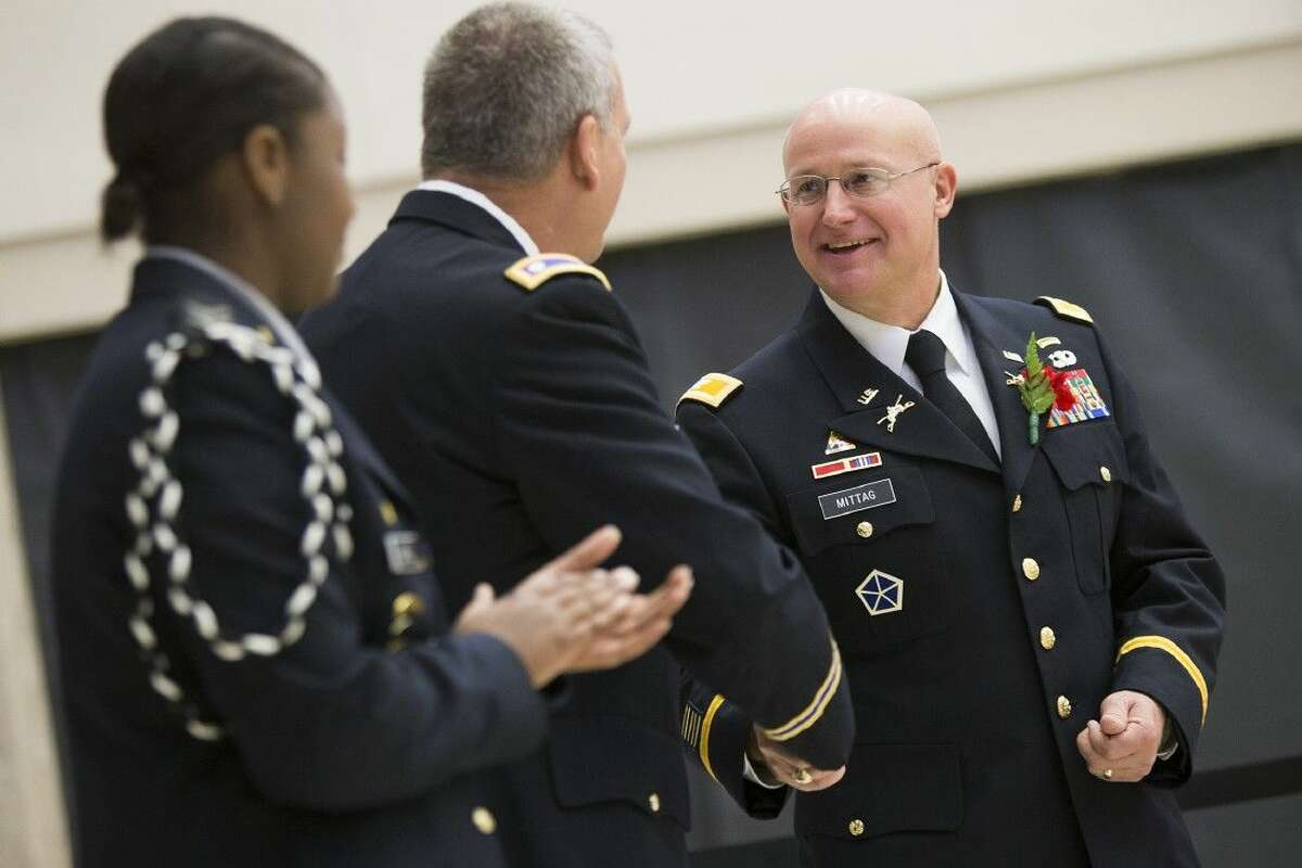 Humble High School graduate Col. Mike Mittag is honored during the Wildcat Salute honoring local veterans and current soldiers Nov. 11, 2014, at Humble High School.