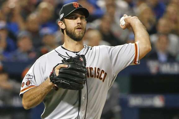 San Francisco Giants starting pitcher Madison Bumgarner (40) throws to first during the first inning of a National League wild-card baseball game against the New York Mets, Wednesday, Oct. 5, 2016, in New York.  (AP Photo/Kathy Willens)