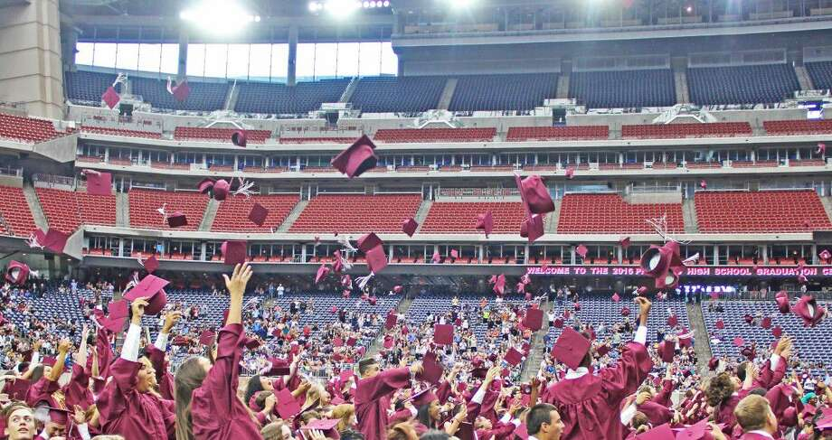 Members of the Pearland High School Class of 2016 celebrate at the close of the Commencement Ceremony. Photo: Kristi Nix