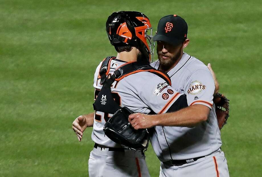 Madison Bumgarner and Buster Posey of the San Francisco Giants celebrate their 3-0 win over the New York Mets during their National League Wild Card game at Citi Field on October 5, 2016 in New York City.  Photo: Michael Reaves, Getty Images