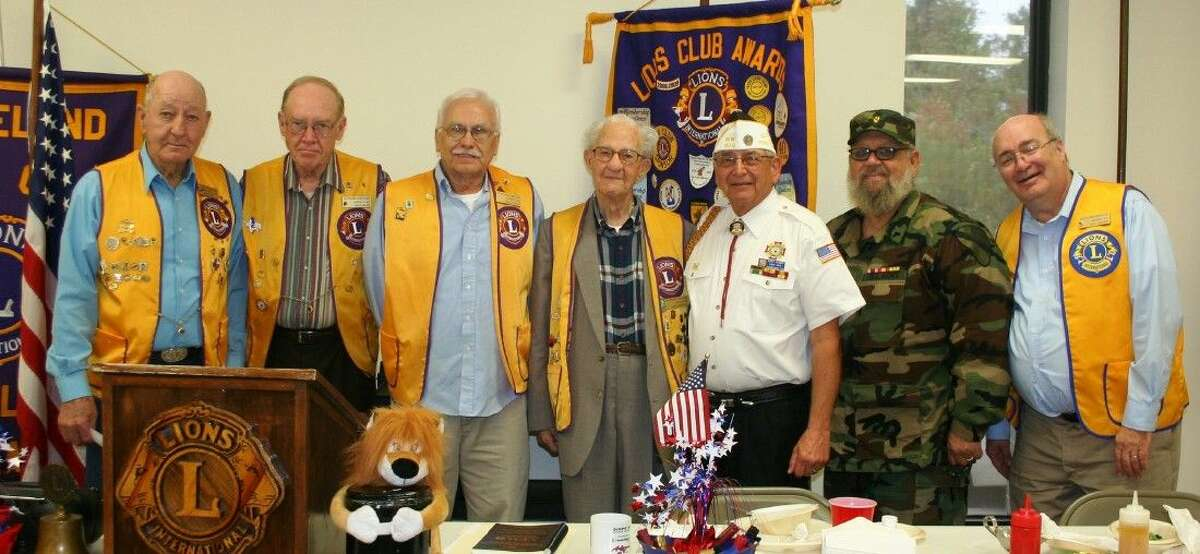 On Nov. 11, members of the Cleveland Lions Club who have served in the U.S. Armed Forces posed with V.F.W. Post 1839 Commander Rick Clardy (third from right) and fellow veteran Larry Fontenot.