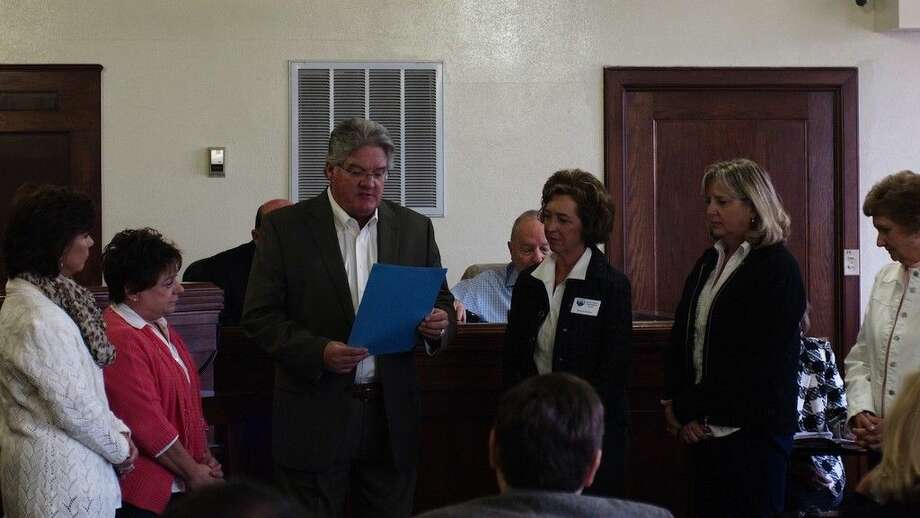 County Judge Craig McNair read a proclamation naming November 2014 as Adoption Month and presented it to the Liberty County Children's Protective Services Board, Nov. 12, 2014.