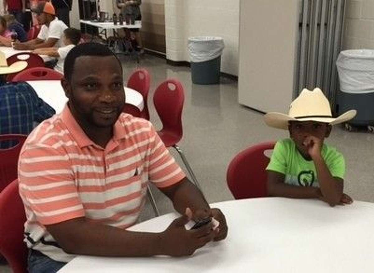 James Street Elementary kindergartner Wendell Wills enjoyed pizza and fun with his dad, also named Wendell, at the Watch DOGS Launch Party on Tuesday, Oct. 20.