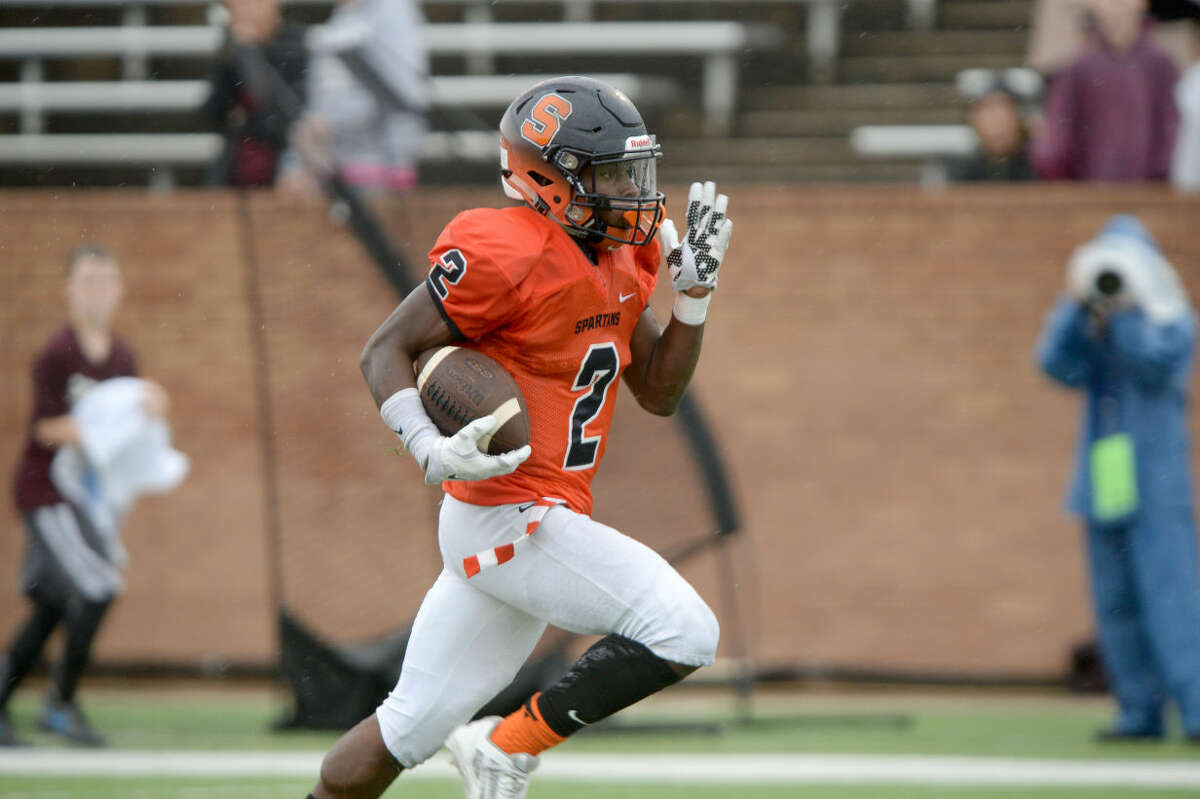 Seven Lakes' Bryan Moore amassed 152 yards and two touchdowns in a District 19-6A game against Cinco Ranch, Oct. 24 at Rhodes Stadium in Katy. To view or purchase this photo and others like it, visit HCNpics.com.