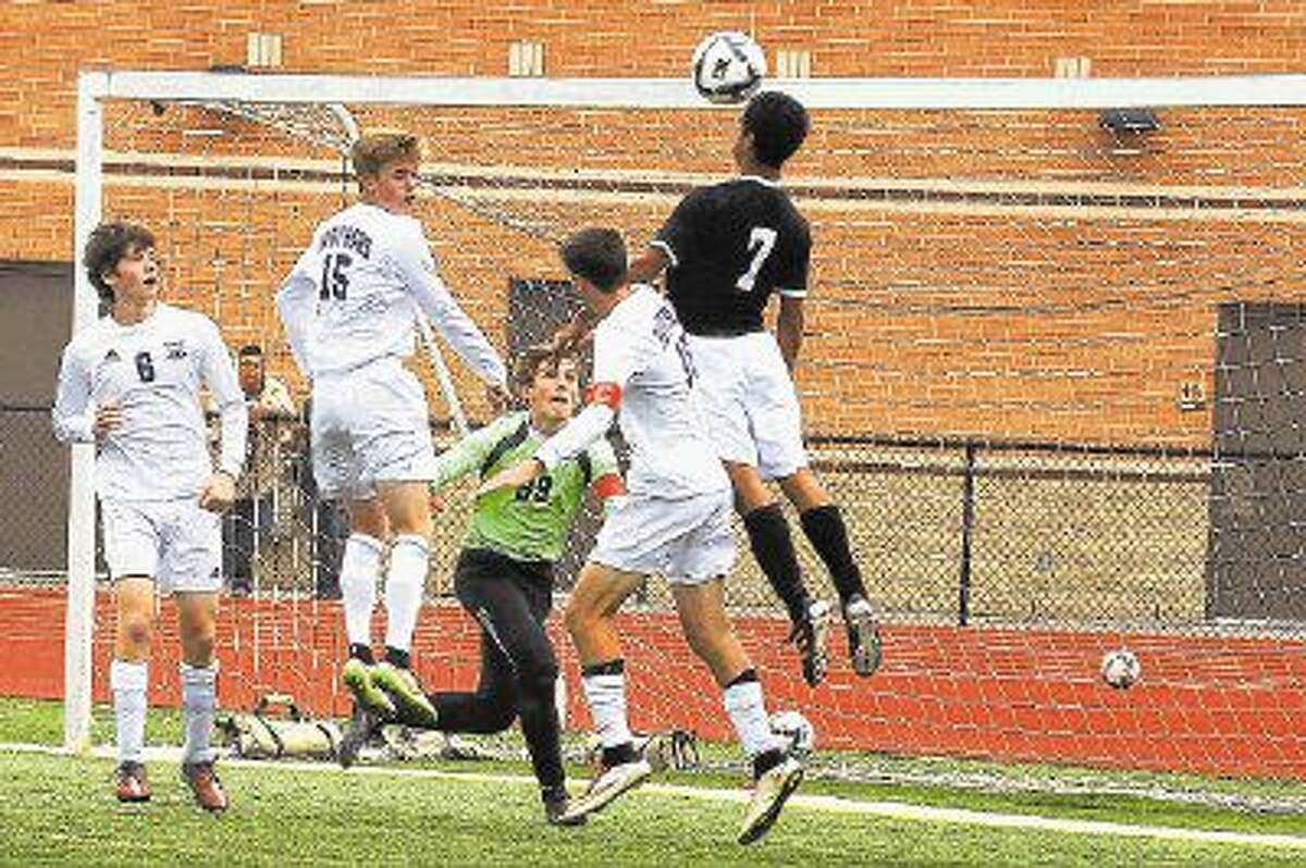 Ridge Point's Ben Garza (6), Brandon Jones (15), Jamie Flynn (16) and Jacob Griffin (99) defend the net against Spring Woods during the 2015 Region III-5A semifinals at Turner Stadium. Flynn was voted the 2016 District 23-5A Defensive MVP.