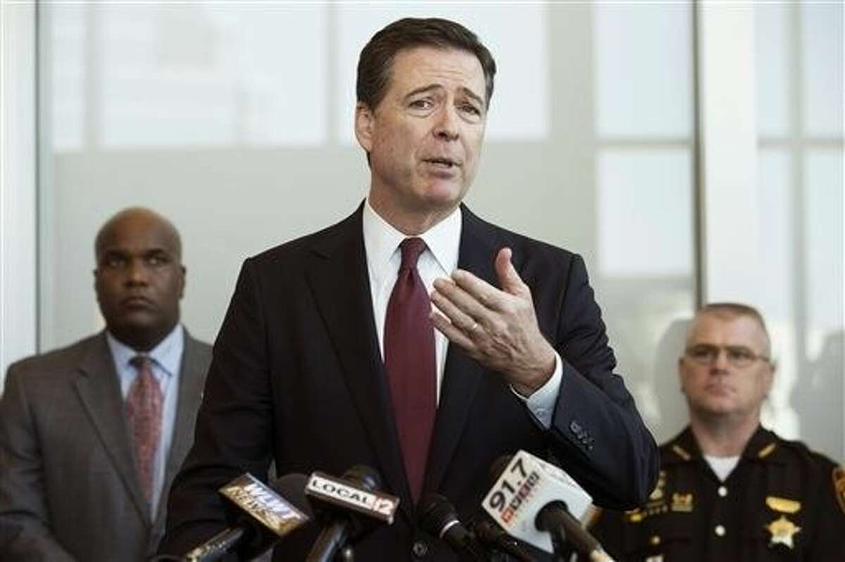 FBI Director James Comey speaks to the media during a news conference at the FBI offices in Cincinnati. Three federal cyberstalking cases that surfaced within a few days of each other in the Cincinnati area have underscored widening challenges in protecting susceptible youths from wily predators.