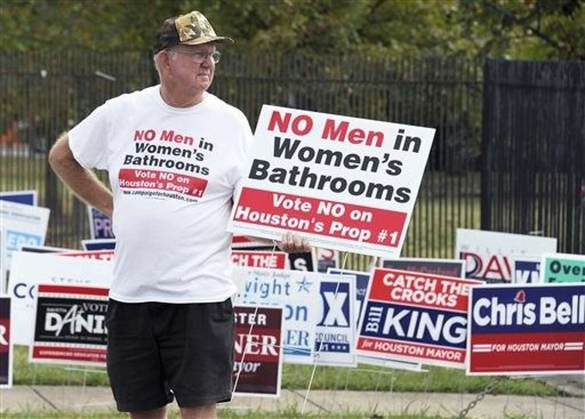 A man urges people to vote against the Houston Equal Rights Ordinance outside an early voting center in Houston on Wednesday. The contested ordinance is a broad measure that would consolidate existing bans on discrimination tied to race, sex, religion and other categories in employment, housing and public accommodations, and extend such protections to gays, lesbians, bisexuals and transgender people.