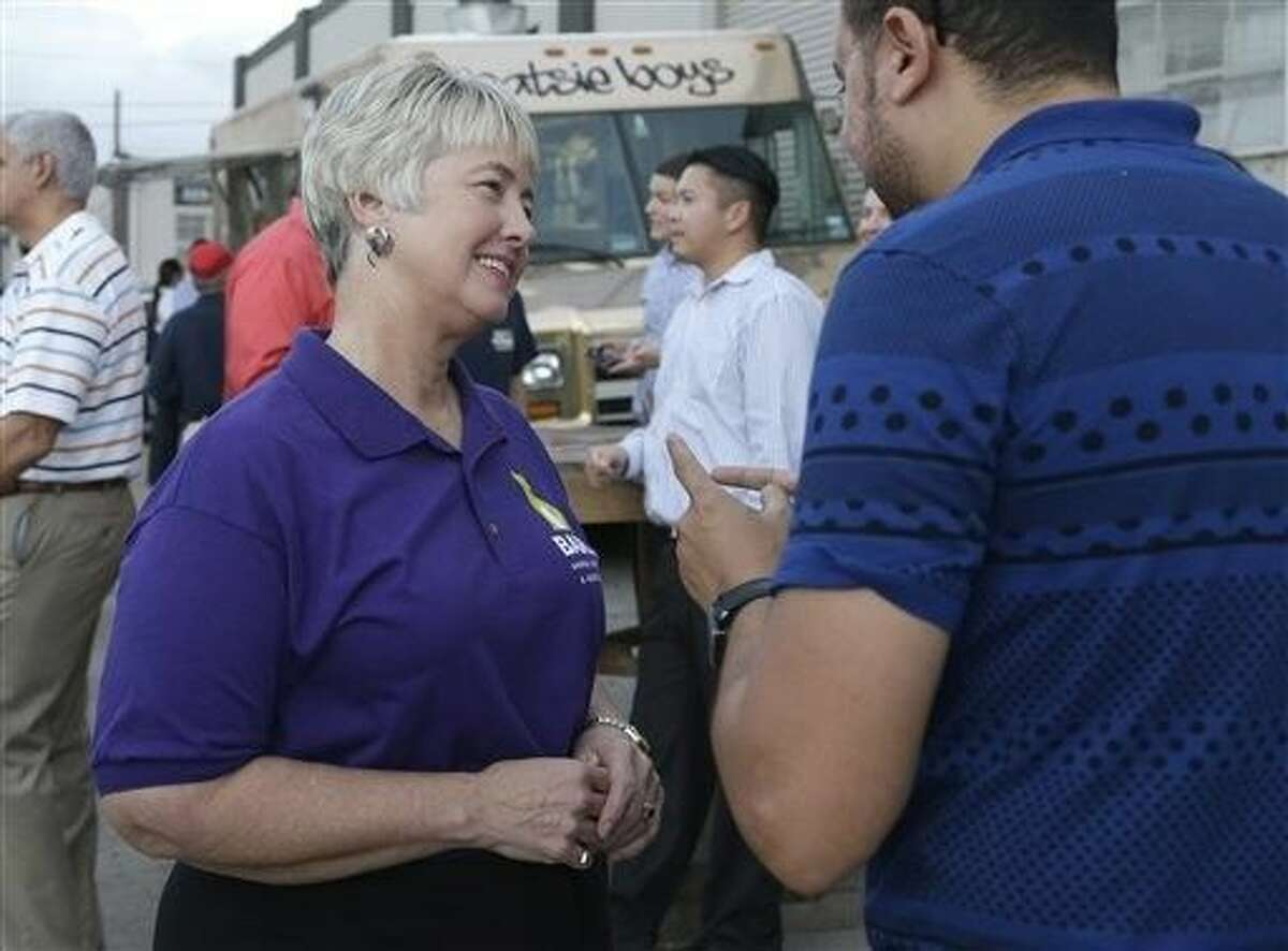 Houston Mayor Annise Parker, left, greets a supporter at a fund raiser for the Houston Equal Rights Ordinance in Houston on Thursday. The ordinance is a broad measure that would consolidate existing bans on discrimination tied to race, sex, religion and other categories in employment, housing and public accommodations, and extend such protections to gays, lesbians, bisexuals and transgender people.
