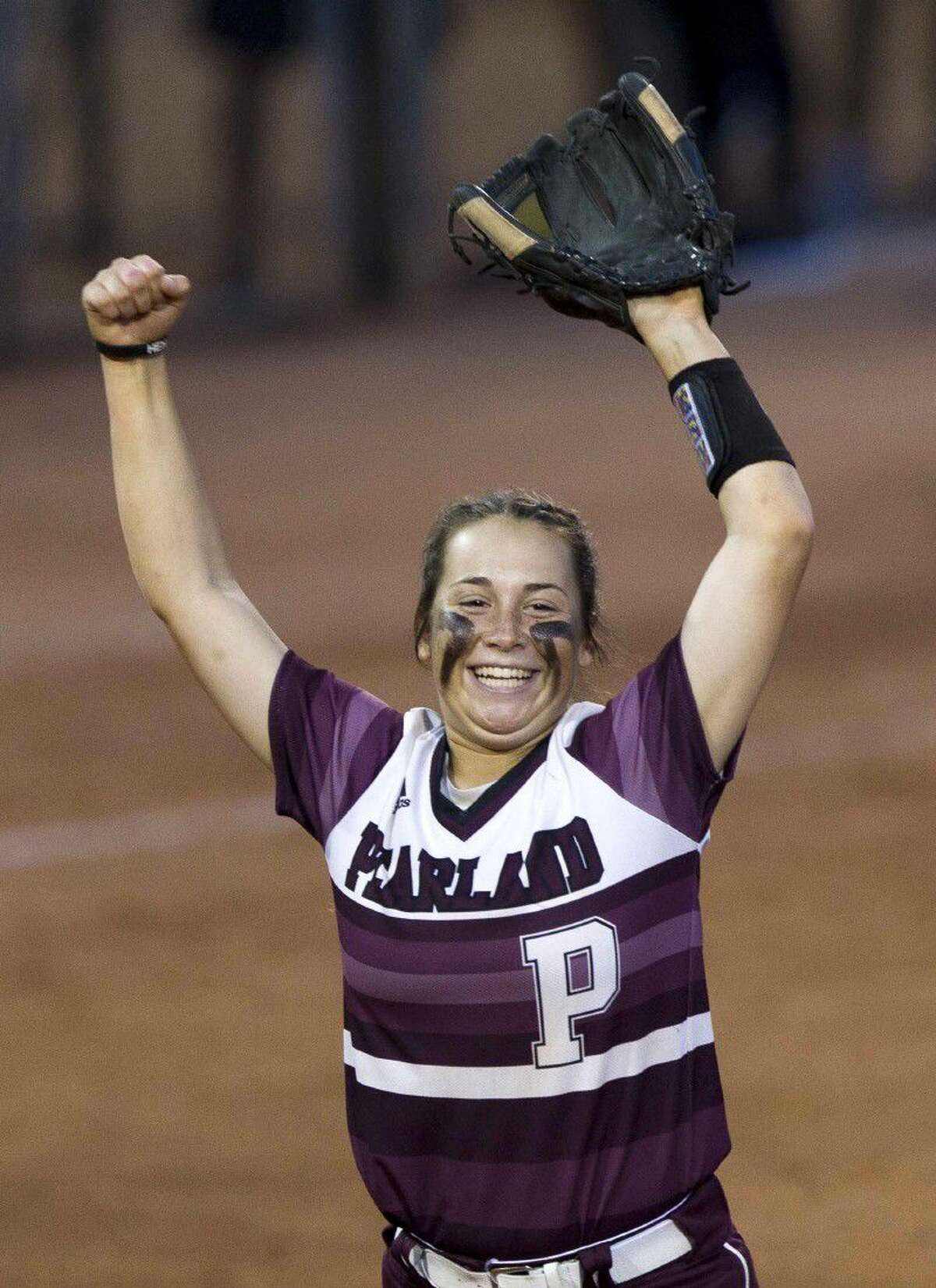 Pearland' third baseman Natalie Romeo celebrates after winning a 6A semifinal game at the UIL State Softball Championships Friday in Austin. Go to HCNpics.com to view more photos from the game.