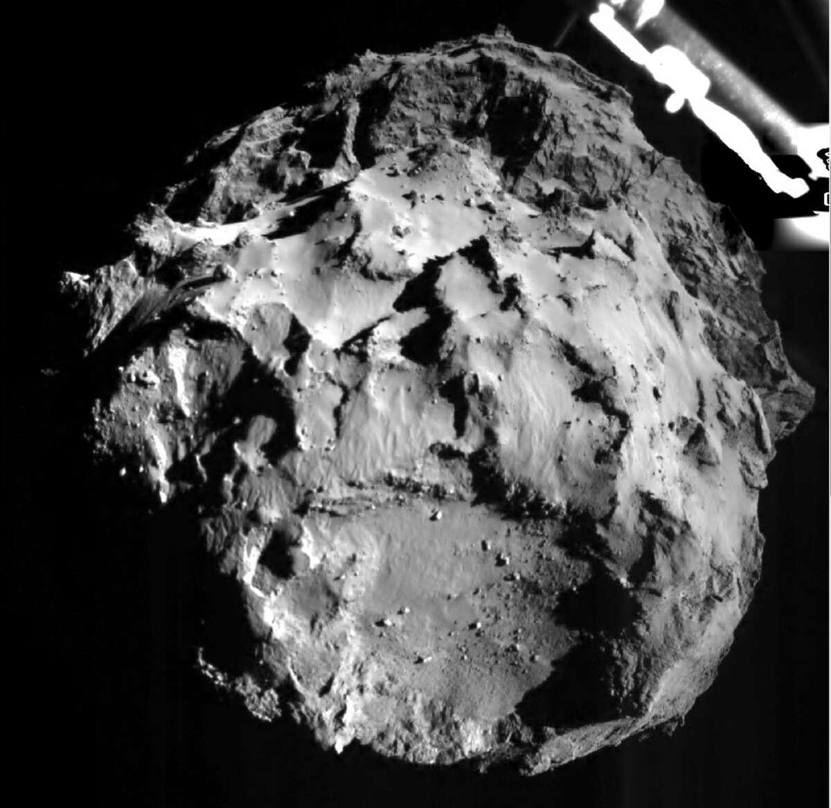 The picture released by the European Space Agency ESA on Wednesday, Nov. 12, 2014 was taken by the ROLIS instrument on Rosetta's Philae lander during descent from a distance of approximately 3 km from the 4-kilometer-wide (2.5-mile-wide) 67P/Churyumov-Gerasimenko comet. Hundreds of millions of miles from Earth, the European spacecraft made history Wednesday by successfully landing on the icy, dusty surface of a speeding comet.