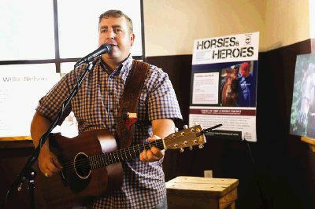 Michael Player performs during the Henry's Home Horse and Human Sanctuary fundraiser on Sunday at Southern Star Brewery.