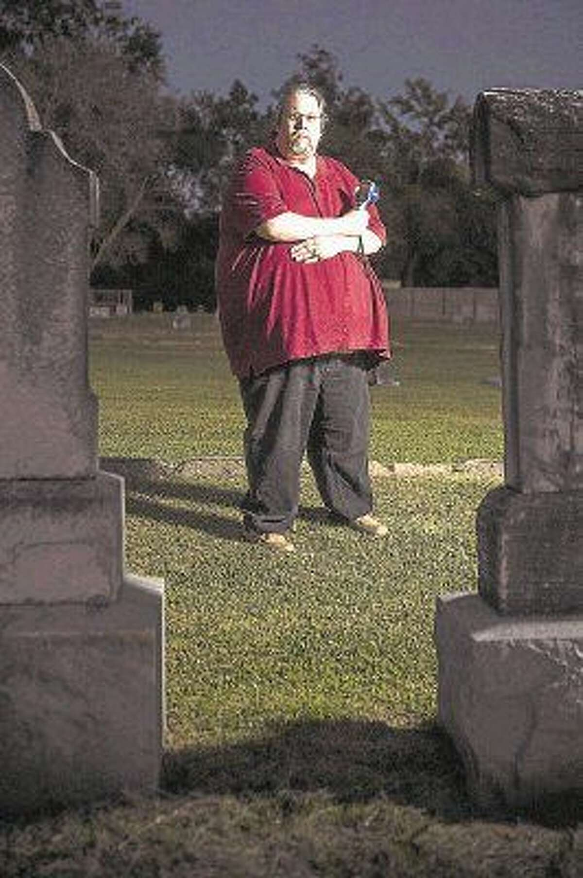 Lone Star Spirits president Pete Haviland poses for a portrait Oct. 24, 2014, at the Humble Cemetery.