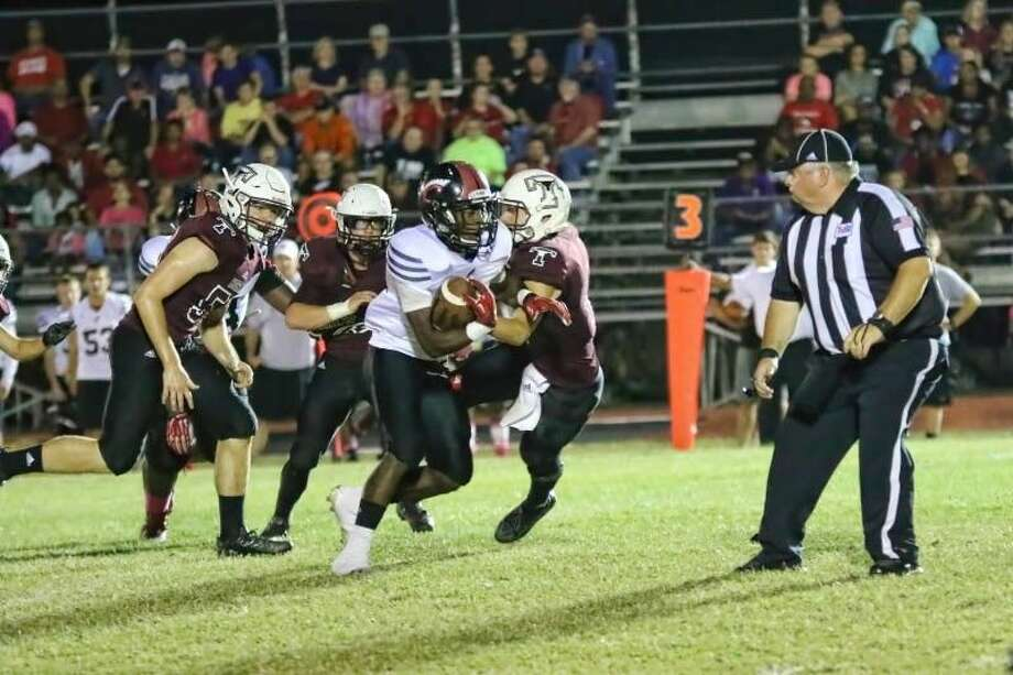 Trojan running back Don Taylor breaks through the Tarkington defense for one of several long runs on the night, Oct. 23, 2015. Coldspring won, 36-7. Photo: Sean Ashley Jones