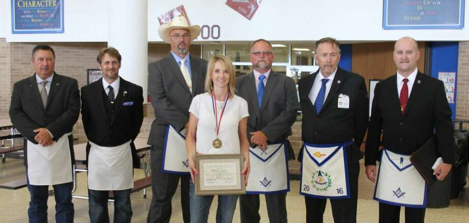 Michelle Coogler (middle) is a Tarkington Middle School math teacher who received the Mirabeau B. Lamar Award from Tarkington Prarie Lodge 498. Pictured left to right are Bobby Jarrell, Kris Rogers, Billy Barrick, Coogler, Ronny Lunsford, Carl Chalfant and Bill Hart. Photo: Jacob McAdams