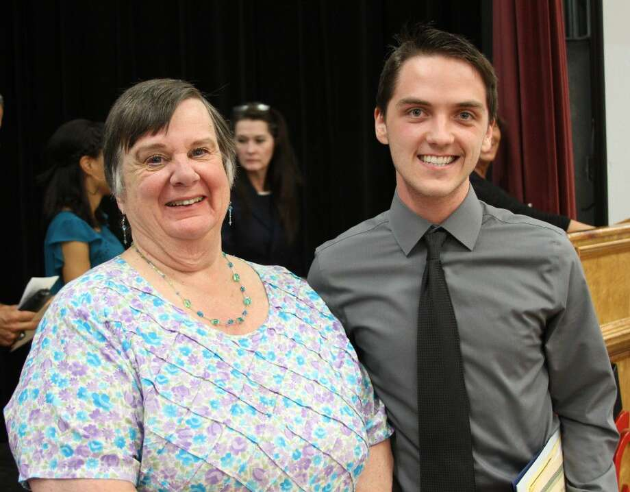 Kathleen Matheu (left) of the Coldspring/San Jacinto County Chamber of Commerce presents a scholarship of $1,500 to Coldspring-Oakhurst CISD student Jared White (right) during the school's awards ceremony on May 31. Photo: Jacob McAdams