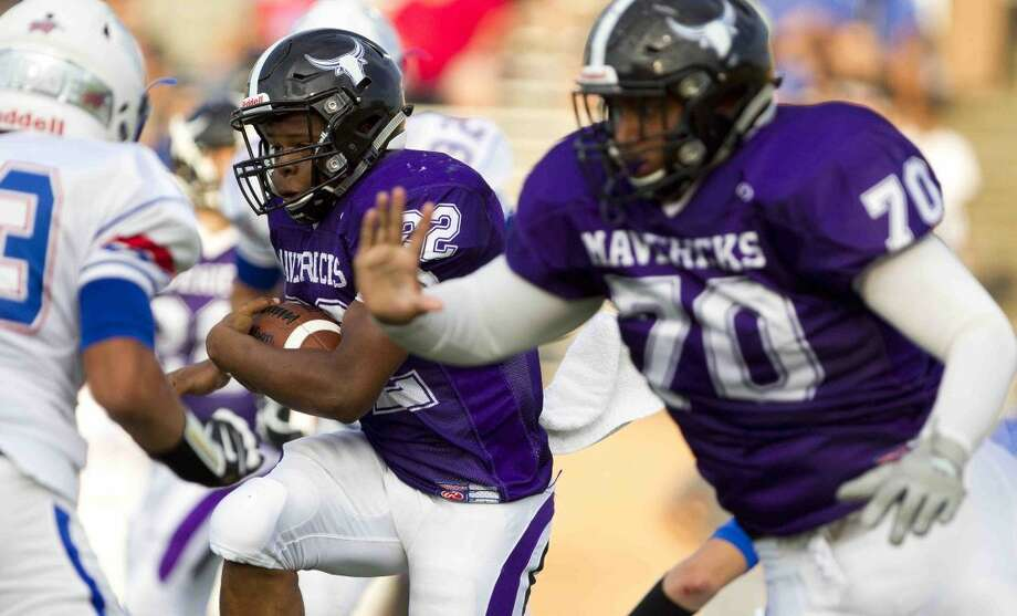 Dartavious Dixon (22), Jonathan Irizarry (70) and Morton Ranch defeated Tompkins 21-0 to pull into fourth place in District 19-6A. Visit HCNPics.com for more photos. Photo: Jason Fochtman