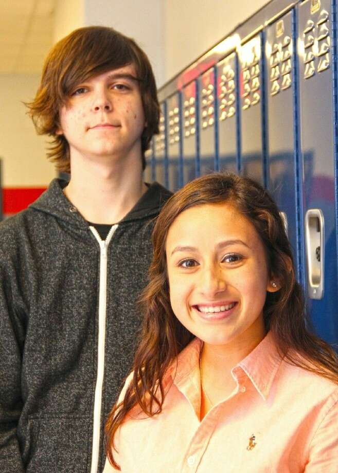 Dawson High School's Joshua Feuless (left) and Alexis Enriquez rank as scholars in the National Hispanic Recognition Program.