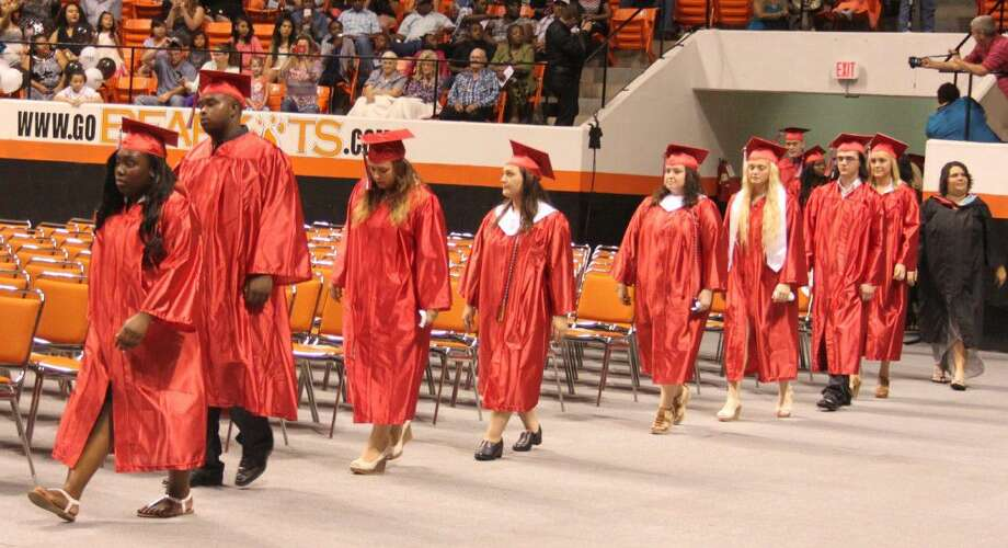 Coldspring-Oakhurst High School seniors make their way into the coliseum at the beginning of the graduation ceremony. Photo: Jacob McAdams