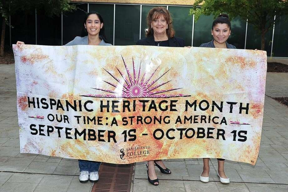 From left, San Jacinto College grant project coordinator Ludith Gonzalez, Dr. Allatia Harris, San Jacinto College vice chancellor of strategic initiatives, and San Jacinto College graduate Danira Garcia display a Hispanic Heritage Month banner. Garcia was a first-place winner as a contestant on the Hispanic College Quiz Show, which was held recently in conjunction with Hispanic Heritage Month. Photo credit: Rob Vanya, San Jacinto College marketing, public relations, and government affairs department.