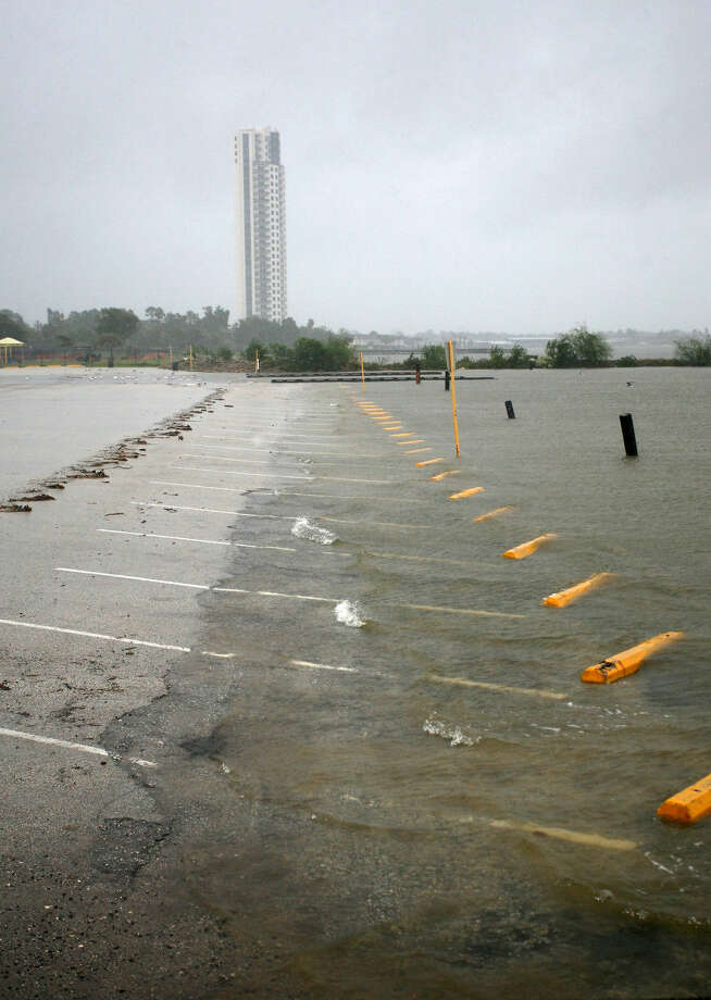 Water encroaches the parking lot at Clear Lake Park as the remnants of Hurricane Patricia passes through Houston on Sunday, October 2015. Photo: Kar B Hlava